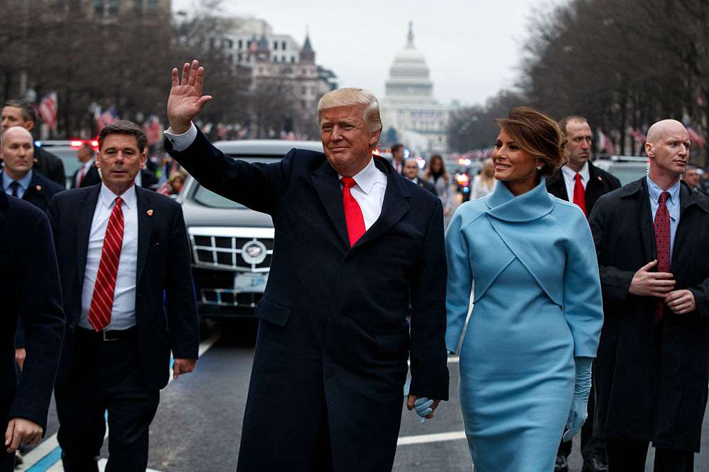 U.S. President Donald Trump waves to supporters with Melania Trump