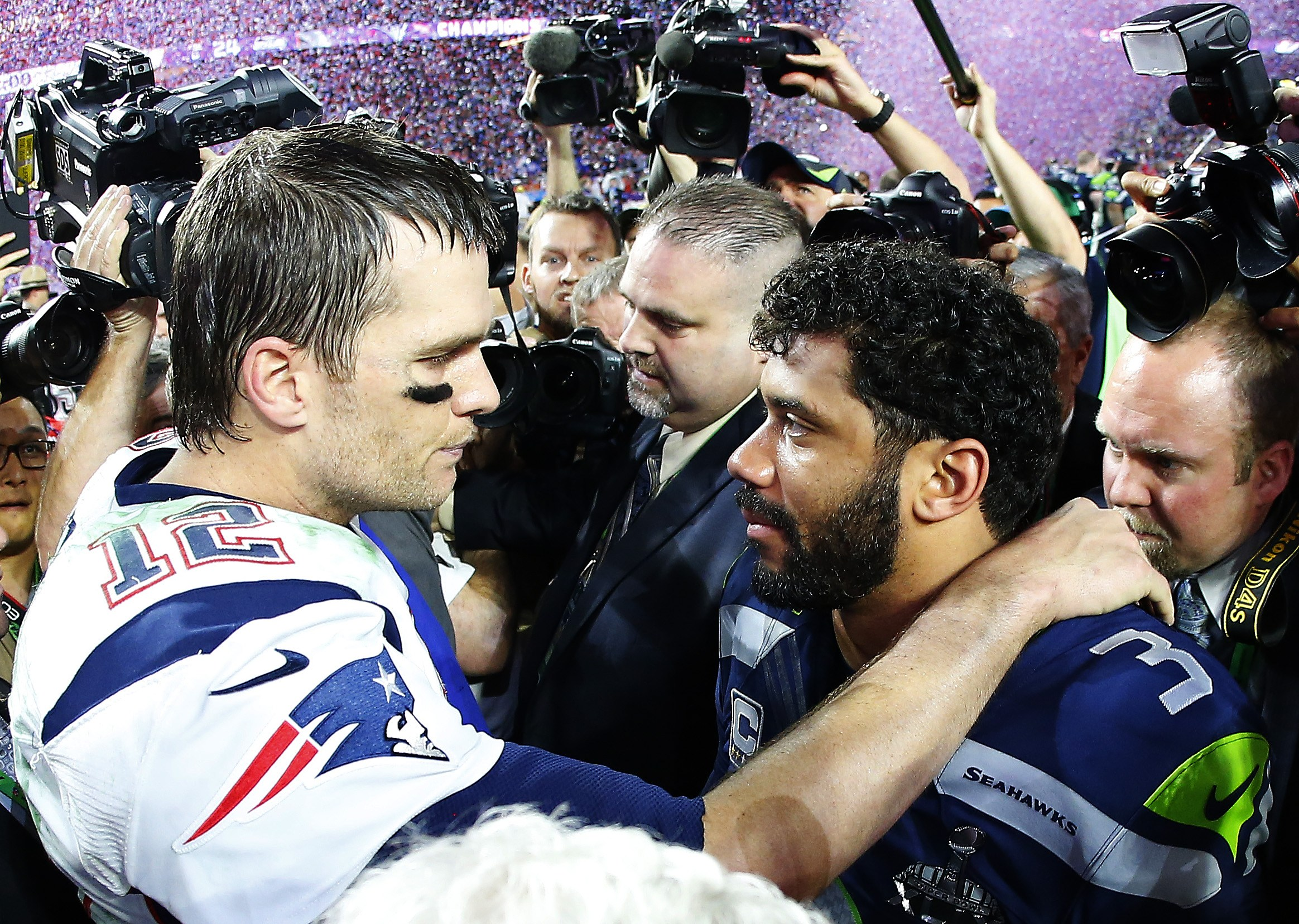 Tom Brady and Russell Wilson greet each other after New England won the Super Bowl.