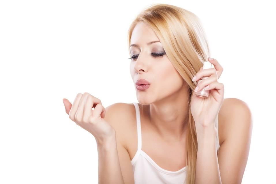 beautiful smiling woman blowing her nail polish