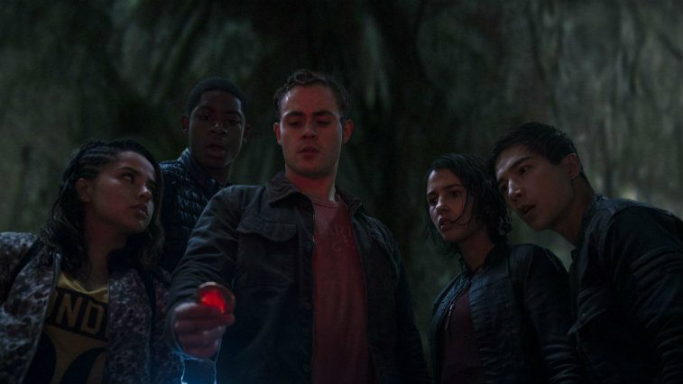 Power Rangers all looking at a red object