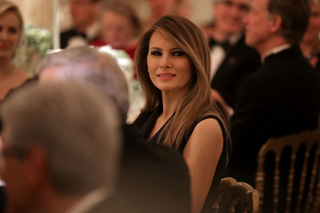 U.S. first lady Melania Trump listens to a toast by her husband, President Donald Trump.
