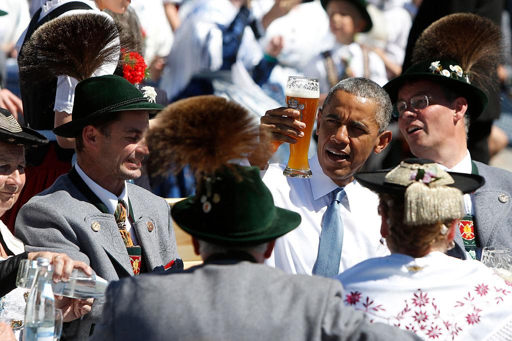 Barack Obama enjoys a beer.