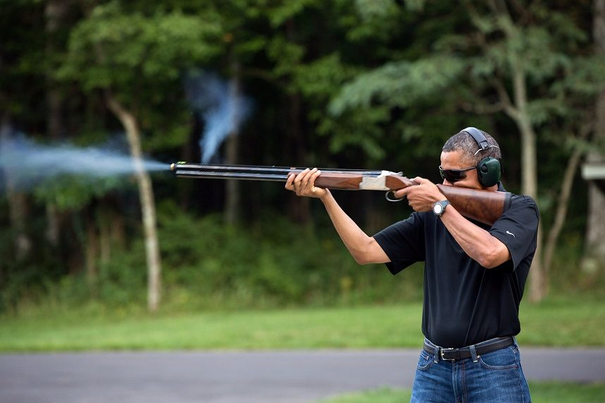 Barack Obama shoots clay targets with a shotgun on the range at Camp David, Maryland