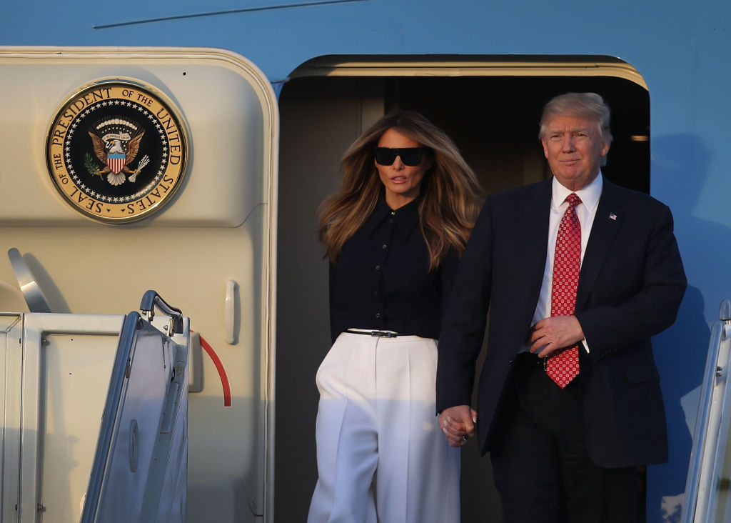 Melania and Donald Trump exit Air Force One.