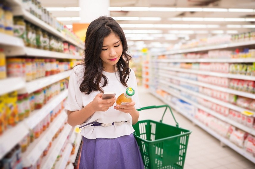 Young woman reading information about the product
