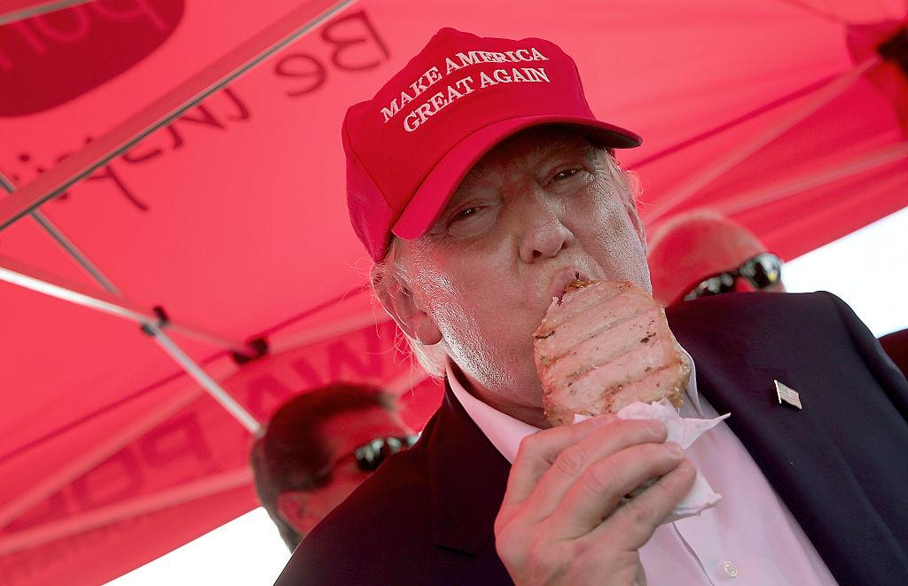 Donald Trump eats a pork chop on a stick.
