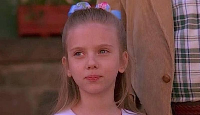 Scarlett Johansson as a little kid looking off.