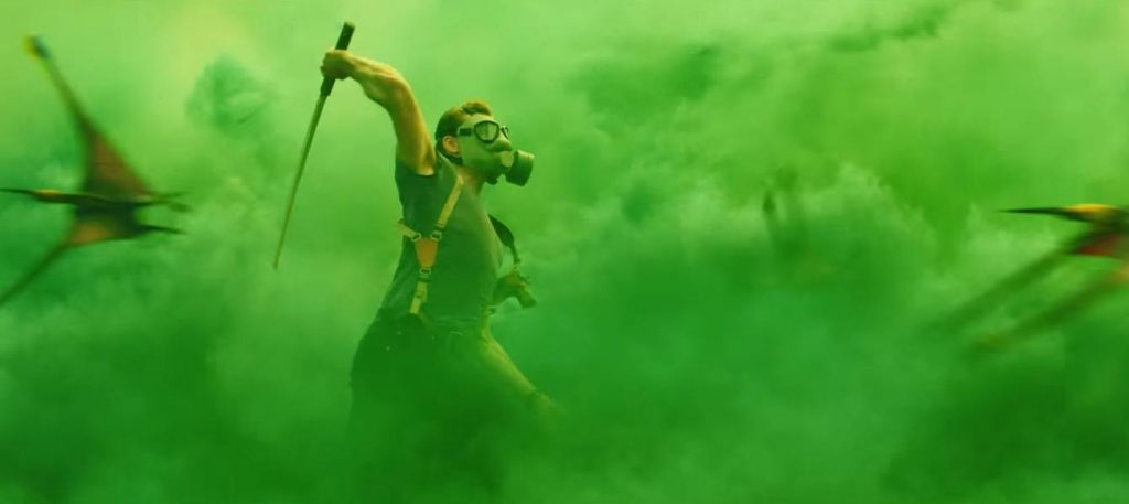 Tom Hiddleston swings a machete in Kong: Skull Island