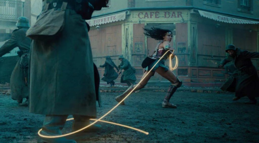 Wonder Woman wields the Lasso of Truth as soldiers run