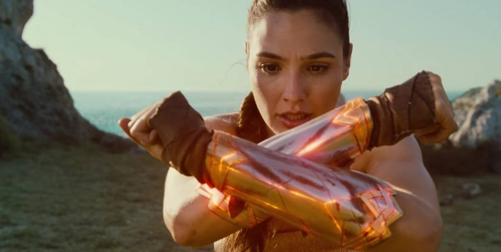 Gal Gadot as Wonder Woman crossing her arms in an x-formation