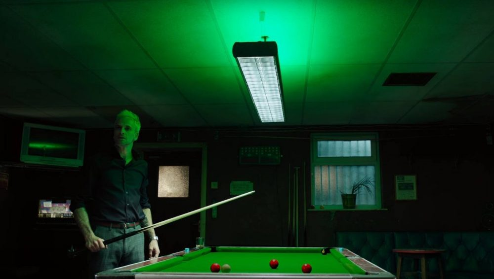 Johnny Lee Miller by a pool table in T2: Trainspotting