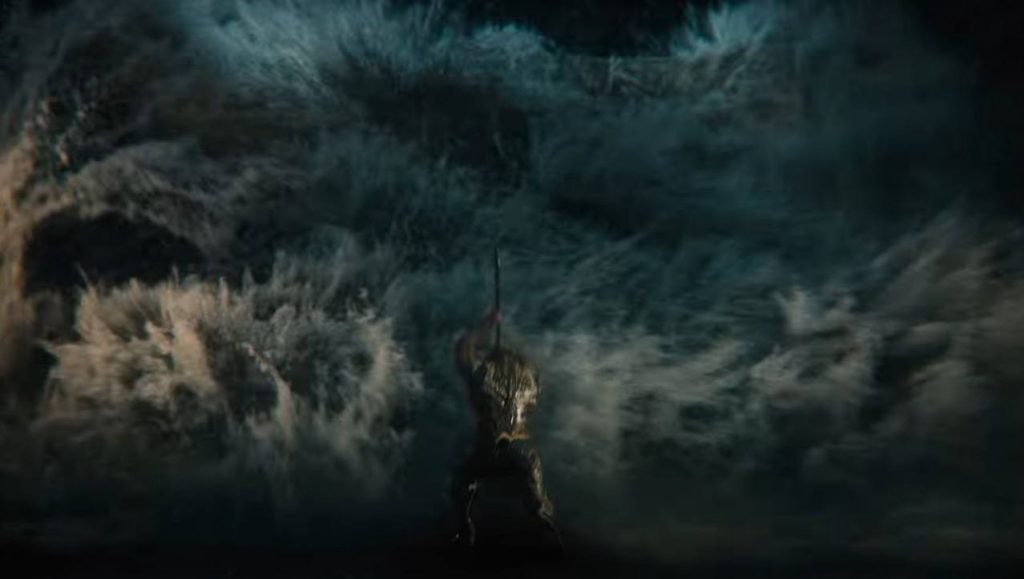 Aquaman slams his trident into the ground and parts the oncoming sea