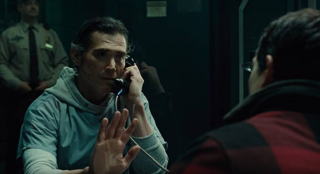 Billy Crudup as Henry Allen, putting his hand up against the glass as he talks to his son while in prison
