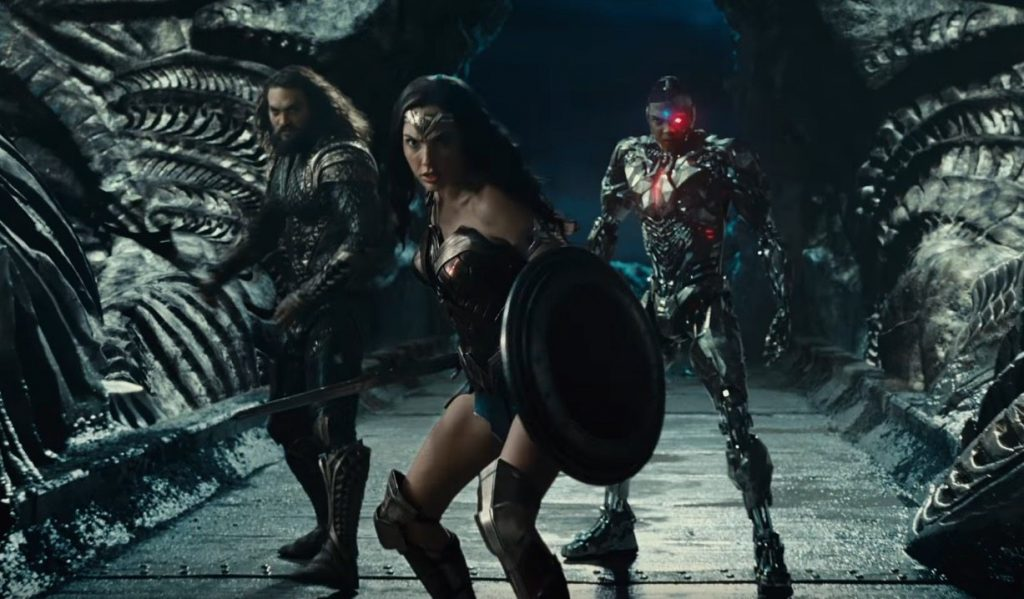 Aquaman, Wonder Woman, and Cyborg strike a pose on a platform in Justice League