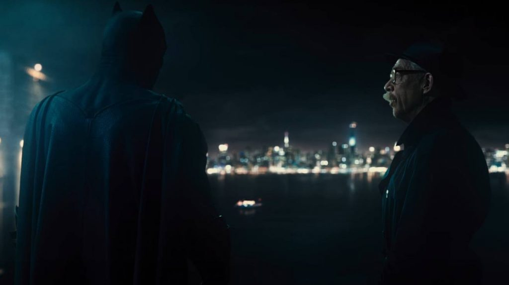 Commissioner Gordon and Batman have a conversation on a rooftop