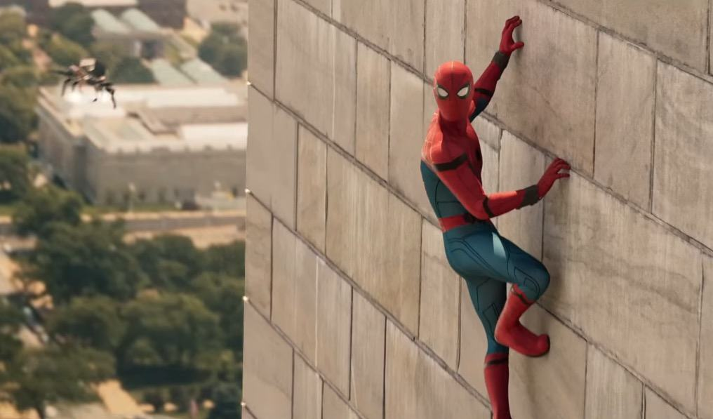 Spider-Man hangs off a wall while flying a new spider drone