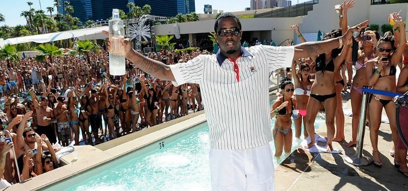Sean Combs holding a bottle of Ciroc at a pool party
