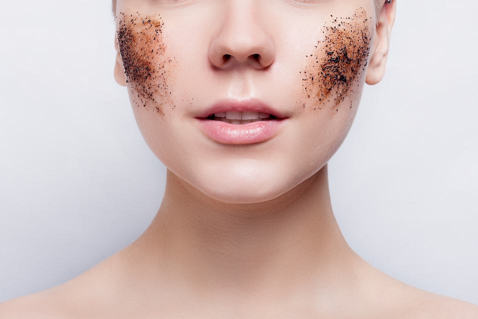 woman with a coffee scrub on her face