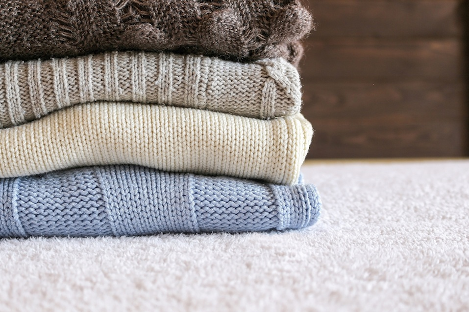 Stack of cozy knitted warm sweater