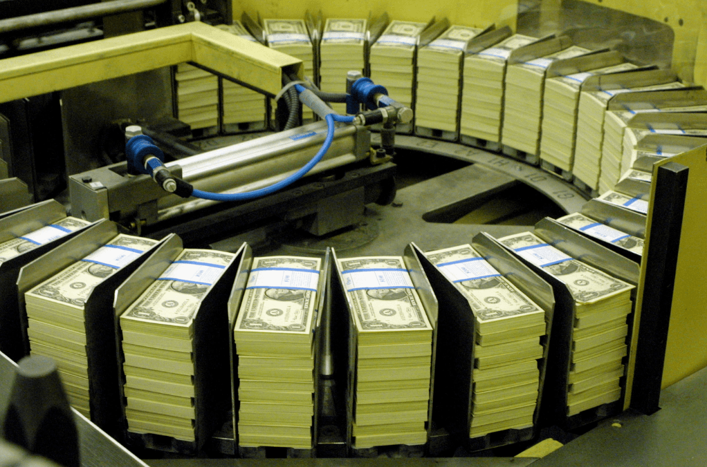 money being sorted at a facility