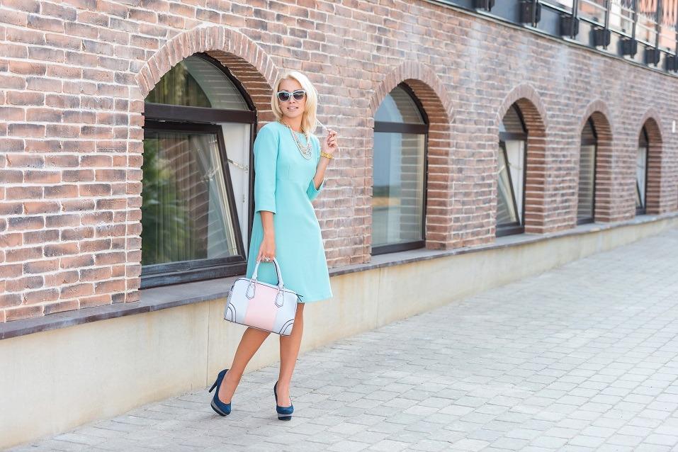 beautiful blonde woman in turquoise dress