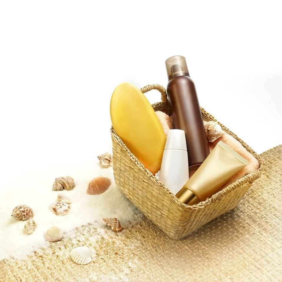 Suntan creams in a beach basket