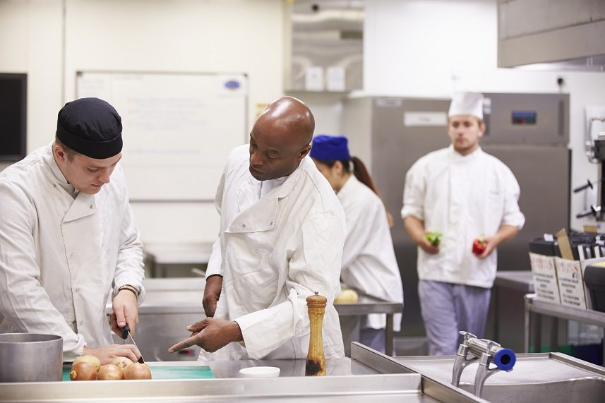 Teacher training students In catering cutting onions