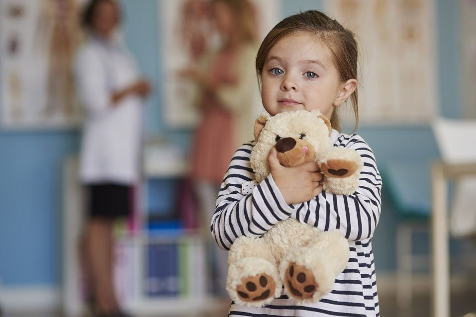 Small girl with toy