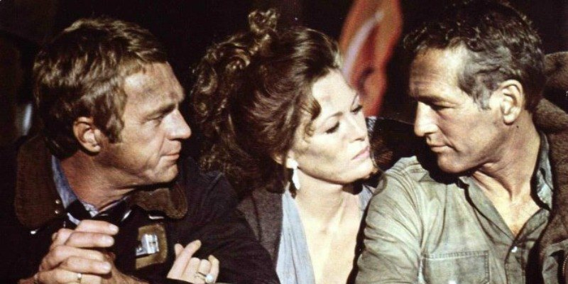 Steve McQueen, Faye Dunaway and Paul Newman sitting down together in The Towering Inferno.