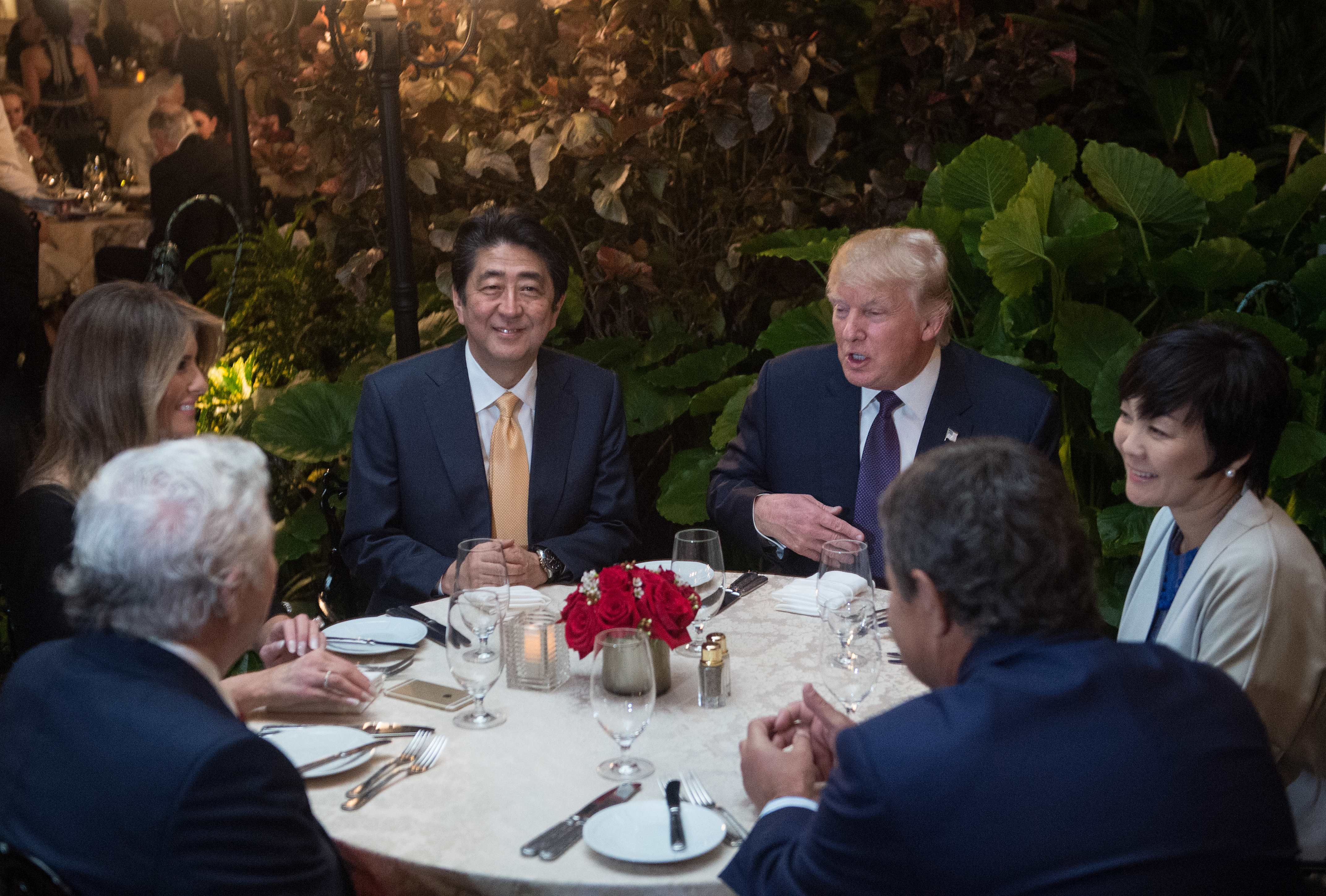 President Donald Trump and other influential people sit down for dinner.