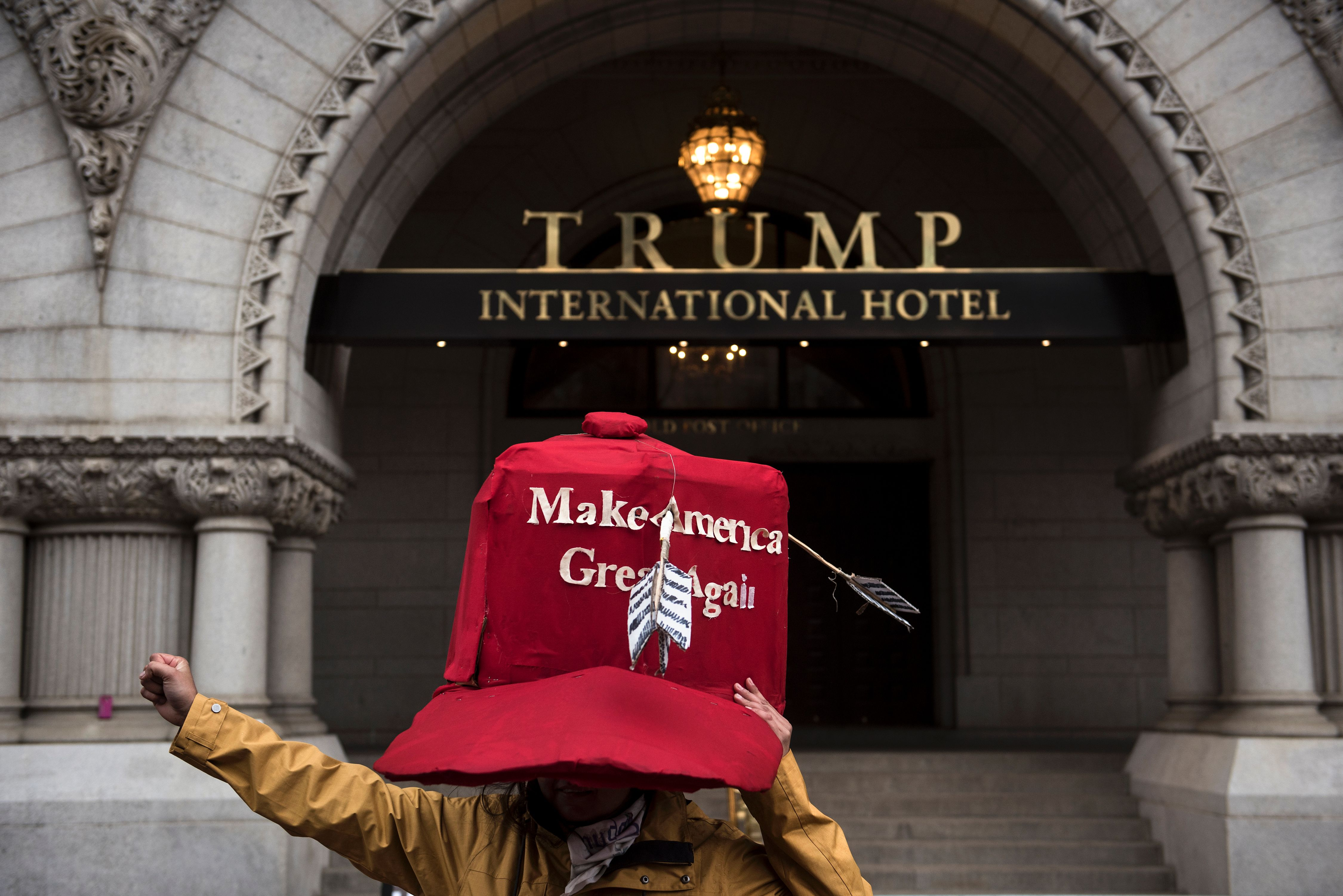 An activist stands in front of Trump International Hotel, one of the Donald Trump hotels