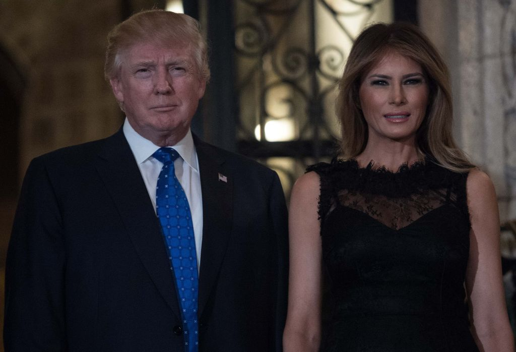 U.S. President Donald Trump and first lady Melania Trummp pose for photos.