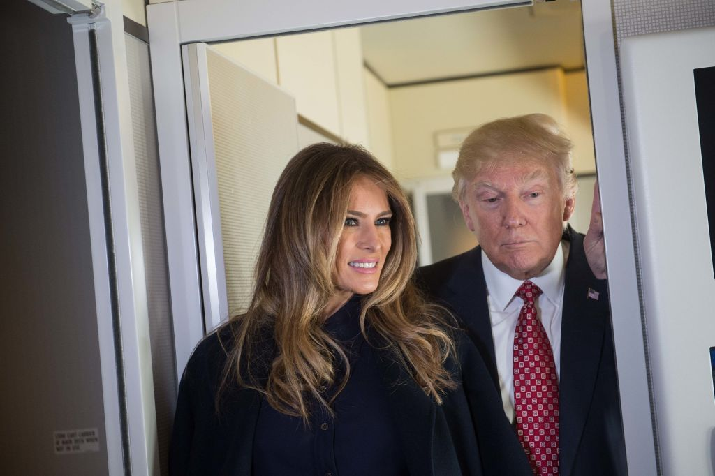 US President Donald Trump speaks to the press with First Lady Melania Trump