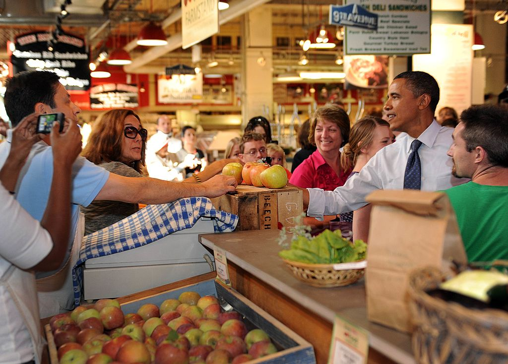Barack Obama greets customers at a grocery store.