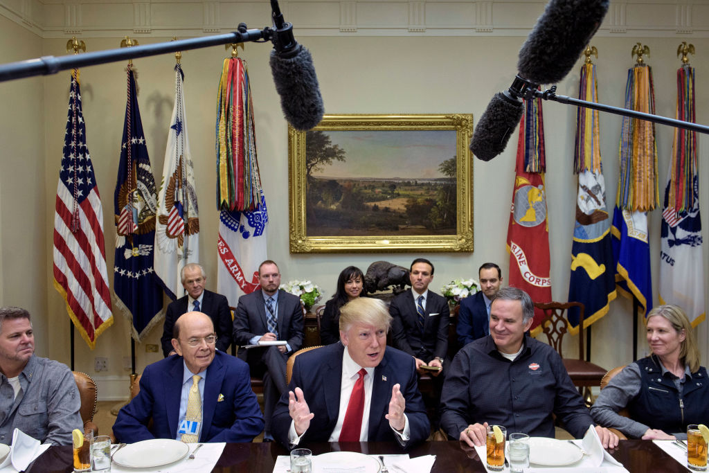 President Donald Trump speaks at a meeting.