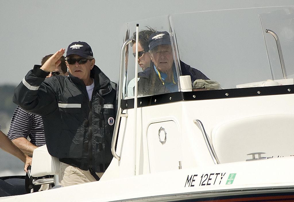 George W. Bush and George H.W. Bush fishing off the coast of Kennebunkport, Maine