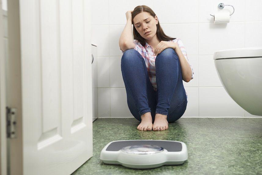Teenage Girl Sitting On Floor
