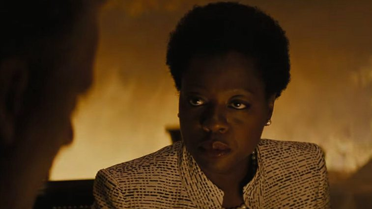 Viola Davis in a suit about to speak in Suicide Squad