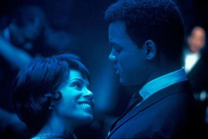 Will Smith and Jada Pinkett dancing together in blue lighting
