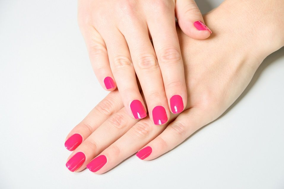 High Angle Close Up of Woman Wearing Bright Pink Polish