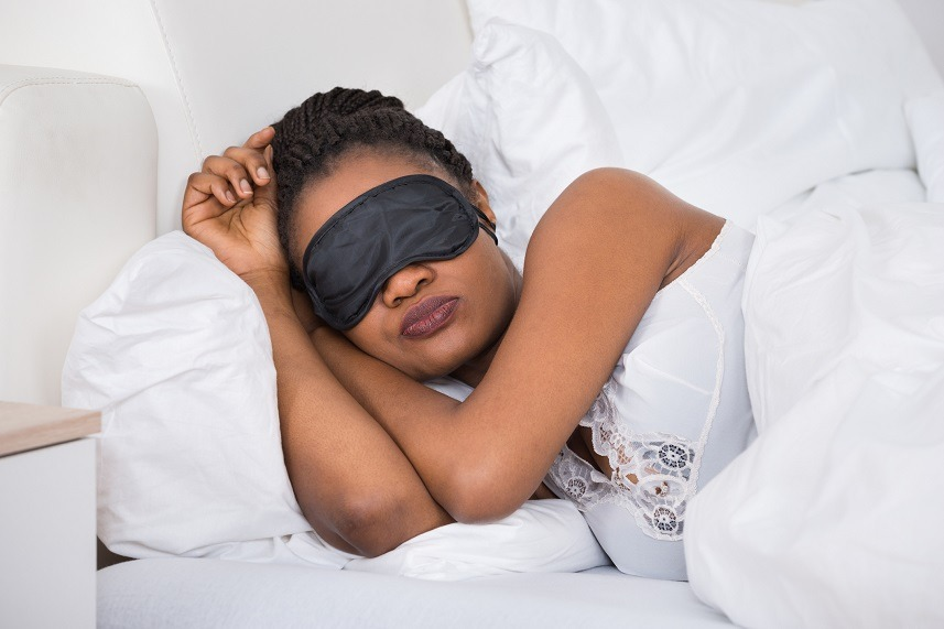 Woman sleeping with eye mask on.
