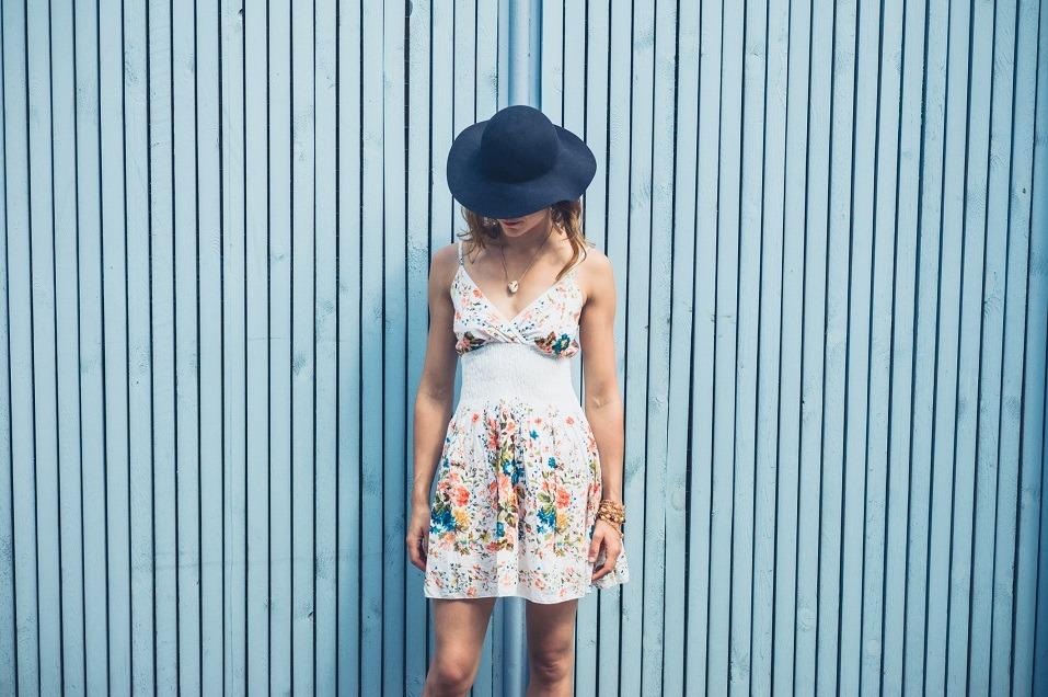 A young woman wearing a summer dress