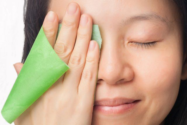 woman wiping her face