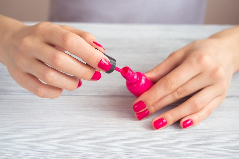 Women's hands with a red manicure