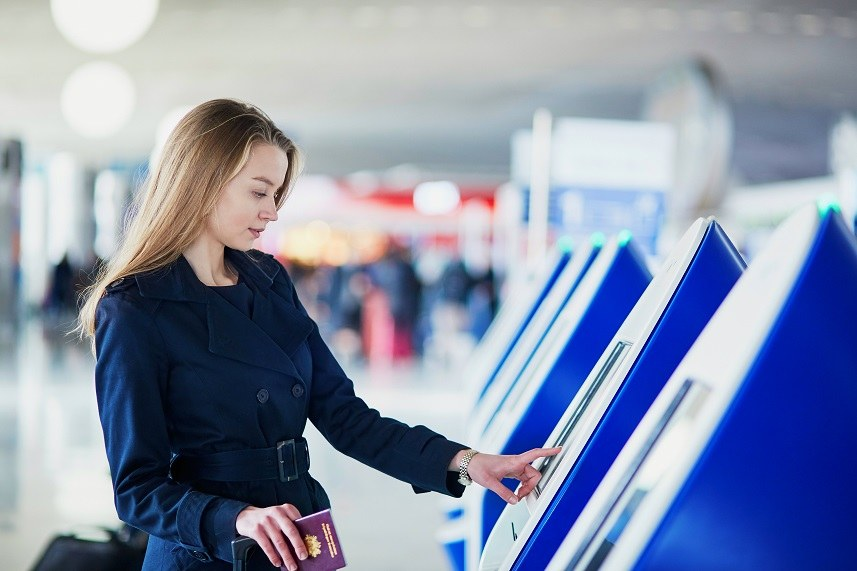 A woman checks in for her flight