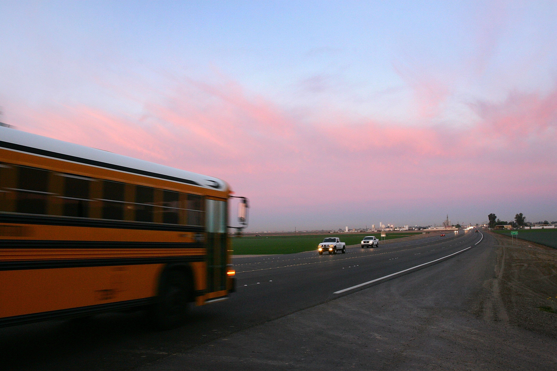 Pre-dawn traffic travels Highway 95 in Arizona