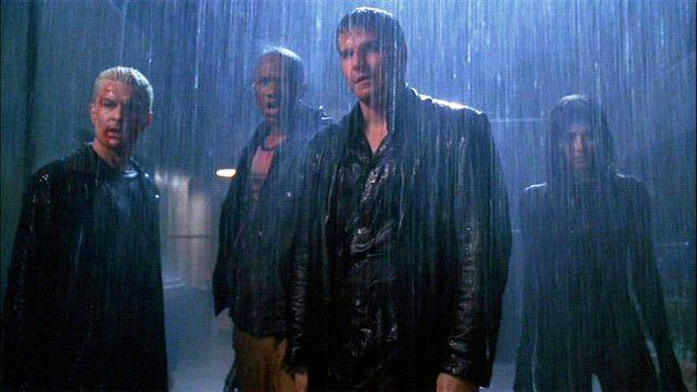 Spike, Gunn, Angel and Illyria stand in the rain in the closing moments of the 'Angel' finale, 'Not Fade Away.'