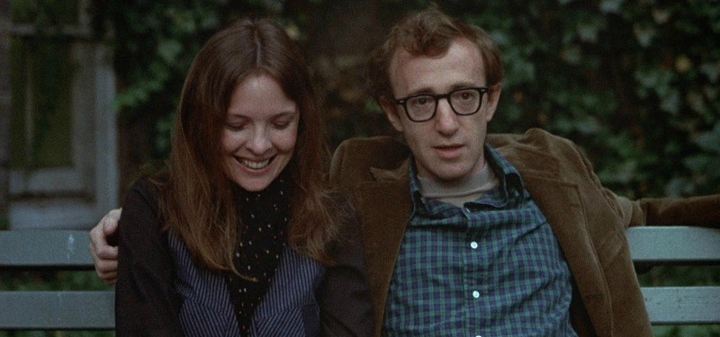 Annie and Alvy sitting on a bench together in Annie Hall.