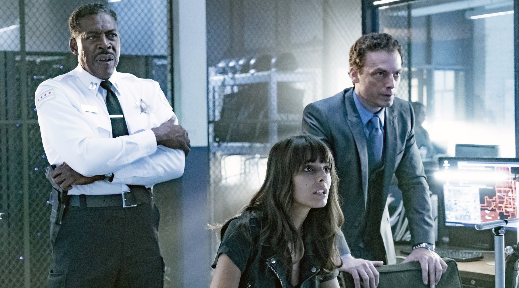 The cast of APB have a tense conference in a scene from the Fox show