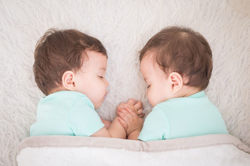 Baby twins sleeping with pacifier